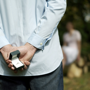a man with a wedding ring behind his back