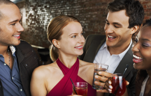two attractive women talking to two men