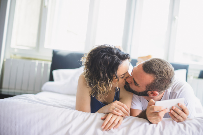 a man and a woman talking intimately and kissing