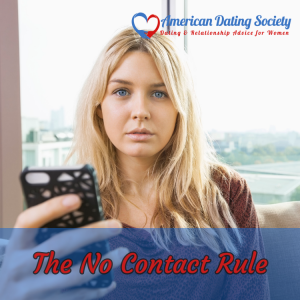 a woman holding a phone the American Dating Society