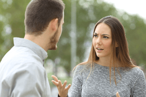 a man and woman talking seriously about saving their marriage