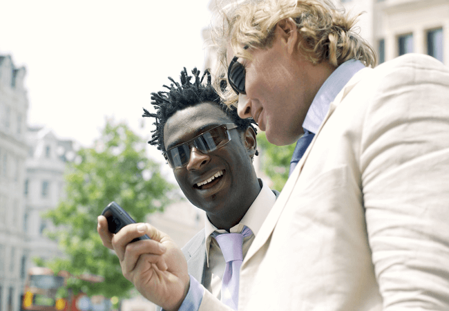 two guys reading a funny text message