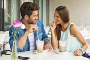 a woman flirting and trying to seduce a guy in a cafe