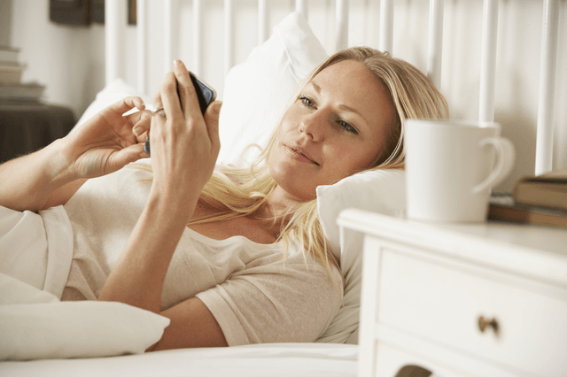 a woman reading a text message from her ex boyfriend